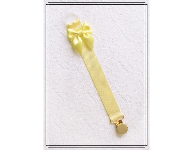 Ljusgul napphållare med rosett - guld