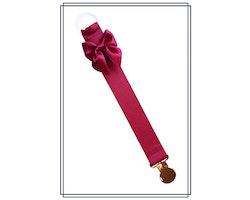 Vinröd napphållare med rosett - guld