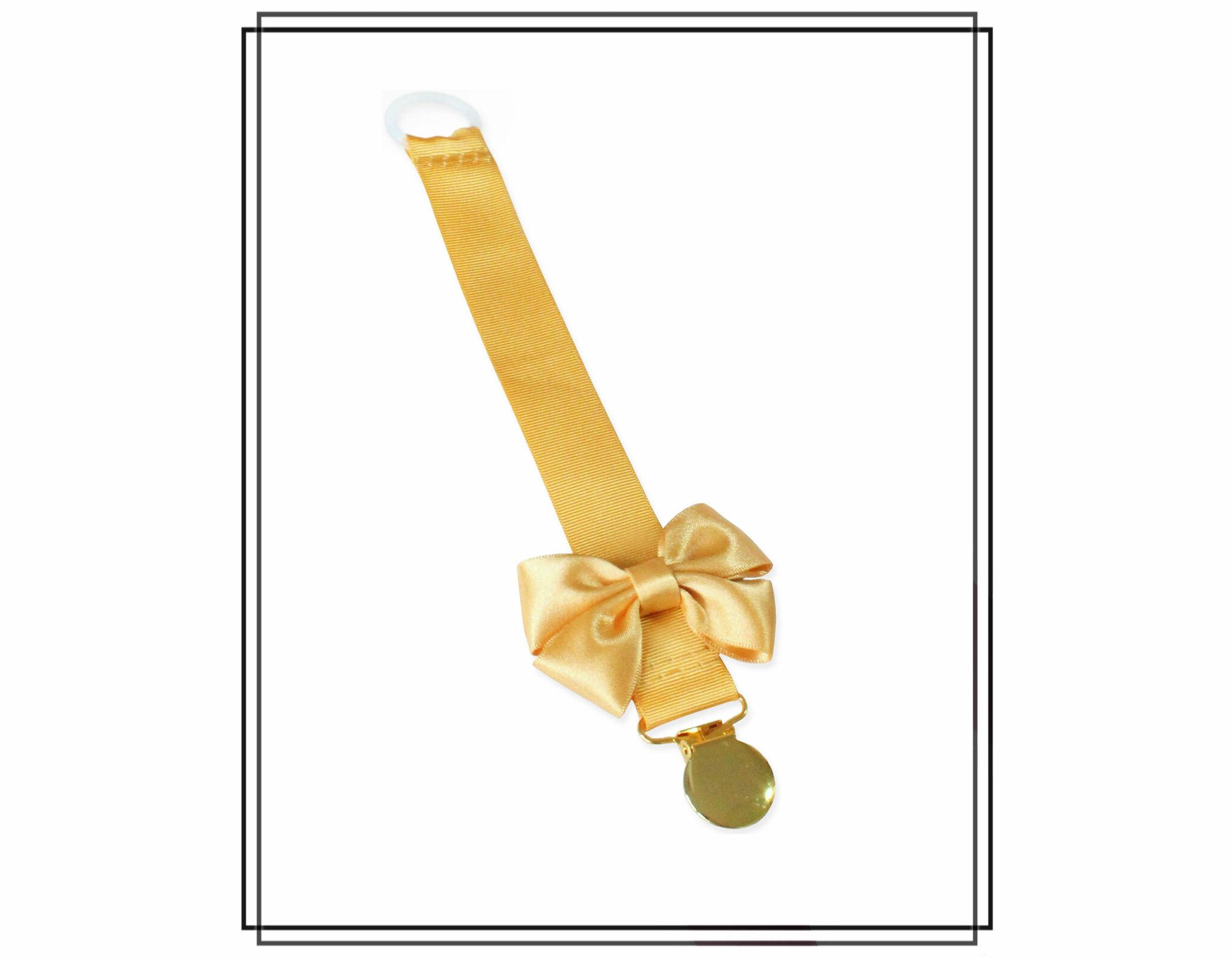 Guldfärgad napphållare med rosett