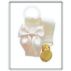 Gräddvit napphållare med champagnefärgad rosett - guld