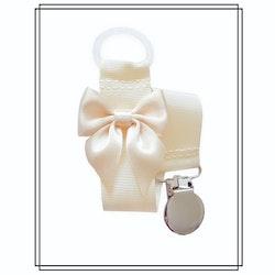 Gräddvit napphållare med champagnefärgad rosett - silver