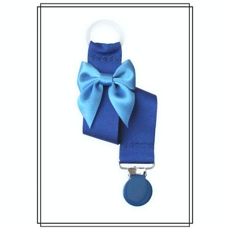 Blå napphållare med mellanblå rosett - blått clip