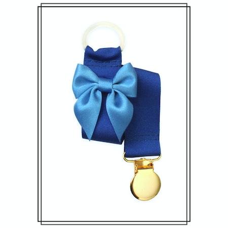 Blå napphållare med mellanblå rosett - guld