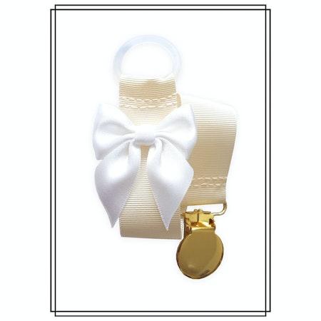 Gräddvit napphållare med vit rosett - guld