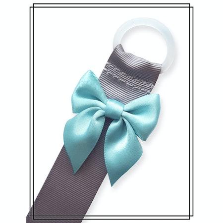 Grå napphållare med ljus turkos rosett - silver