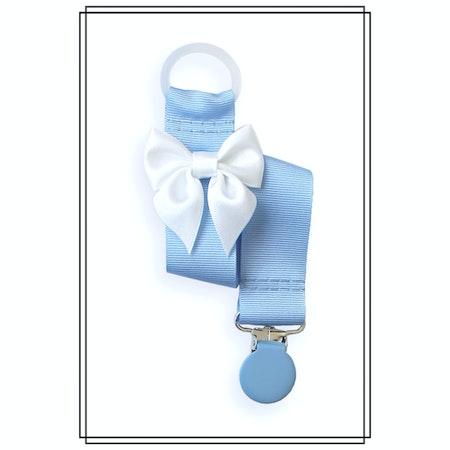 Ljusblå napphållare med vit rosett