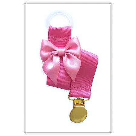 Cerise napphållare med rosa rosett - guld