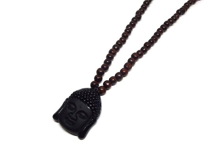 Långt brunt halsband i trä med Buddha huvud i kristall