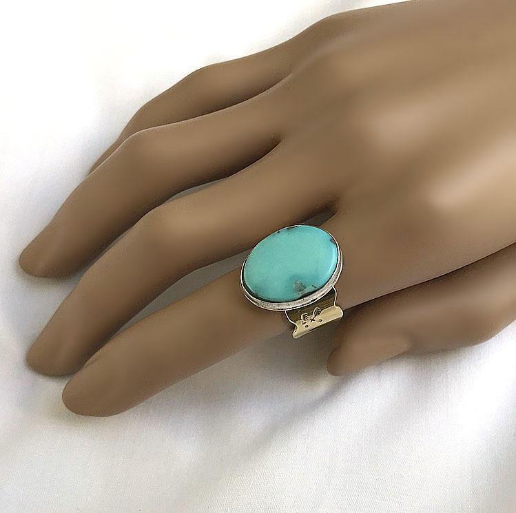 Mässing ring med stor turkos sten.