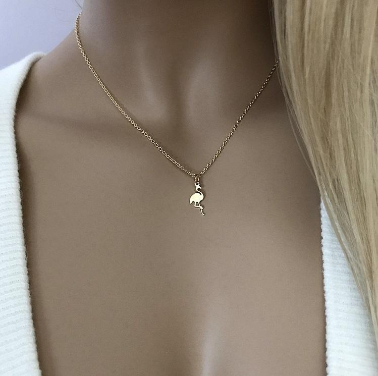 Halsband med fågelhänge