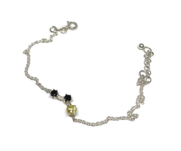 Armband svart och gult silver