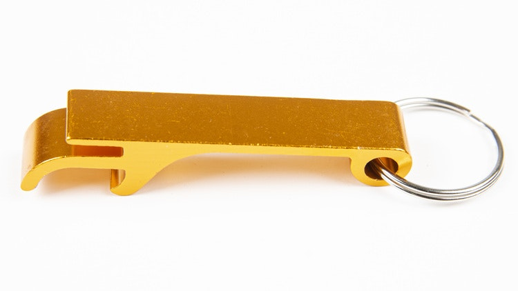 Kapsylöppnare guld