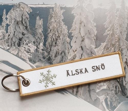 ÄLSKA SNÖ Nyckelring/Tag