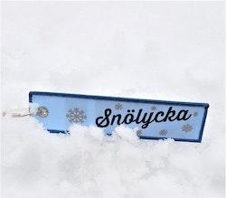 SNÖLYCKA -  Nyckelring/tag