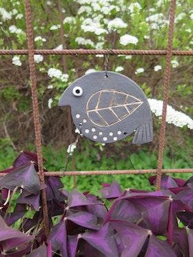 Trädgårdsfågel, svart vänster