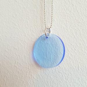 Halsband Cirkus - transparent svagt blå