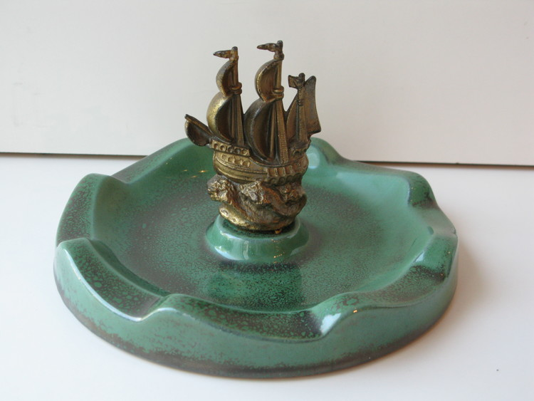 Green bowl with metal ship