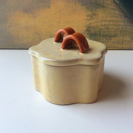 Yellowish jar with lid