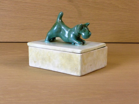 Green dog on a box 2