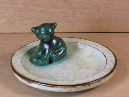 Sitting green bear in a bowl sold