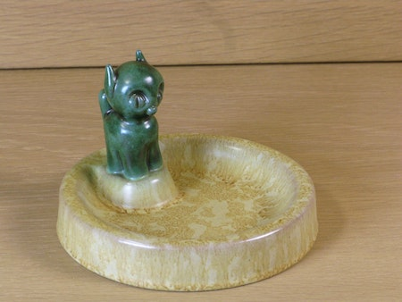 Green cat in a bowl