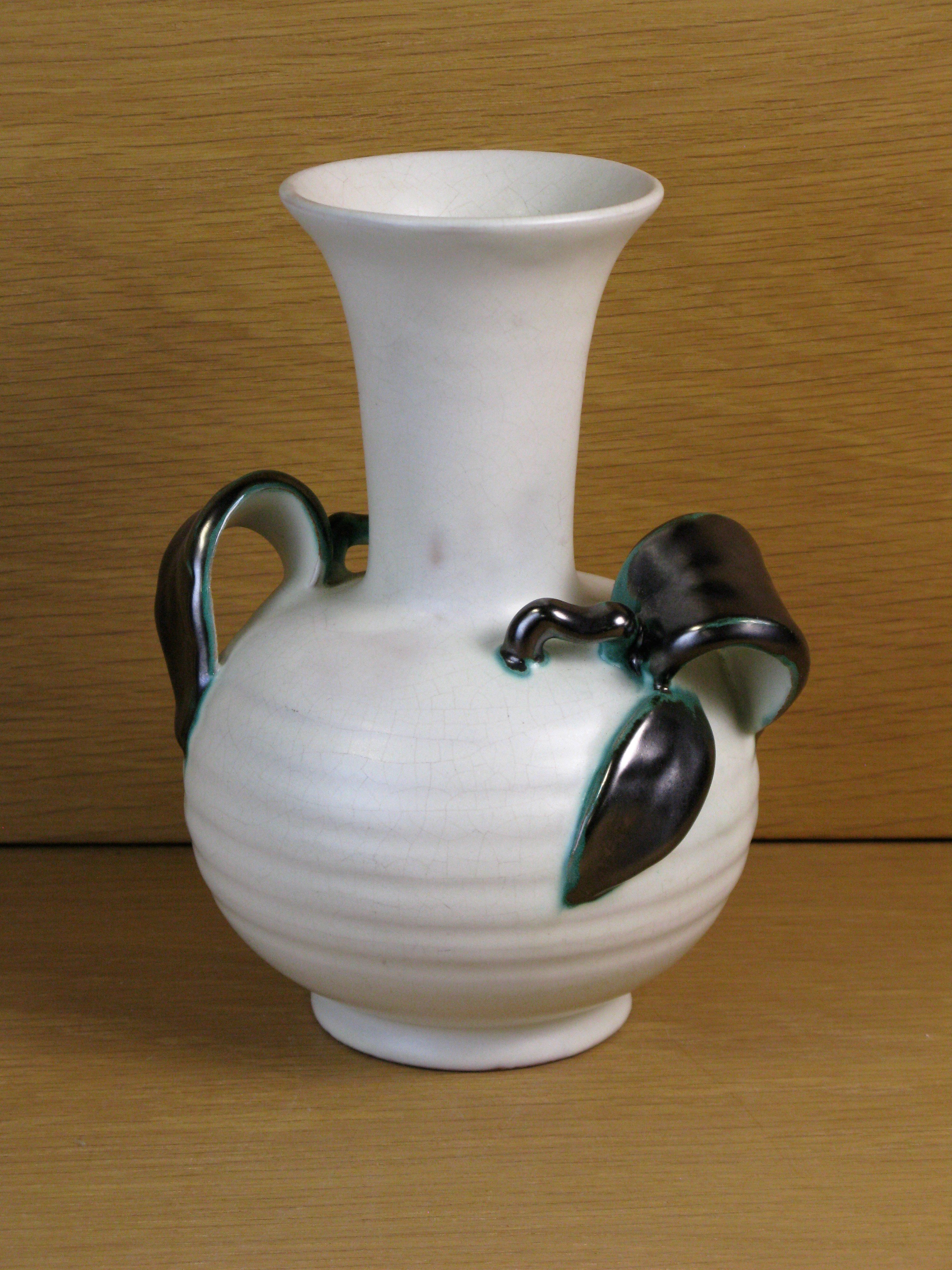 White vase with green handles 224