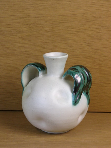 white vase with green handles 190