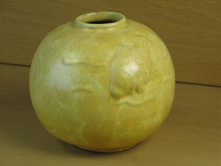 Yellow vase with fish relief