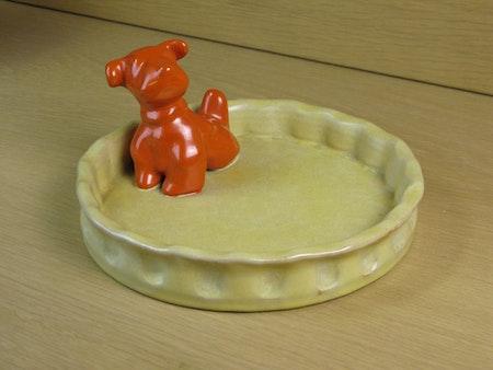 orange dog in yellowish bowl 12