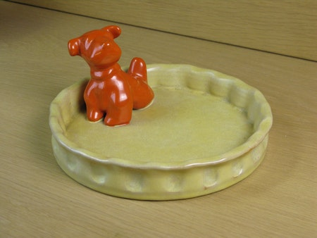 orange dog in yellowish bowl 12