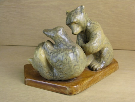 playing bears on wooden plate