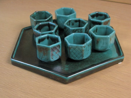 green cups on tray