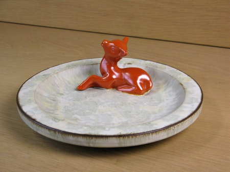 orange deer in greyish ashtray 46