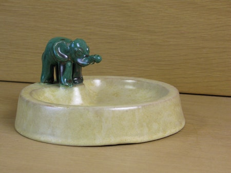 green elephant on yellowish bowl