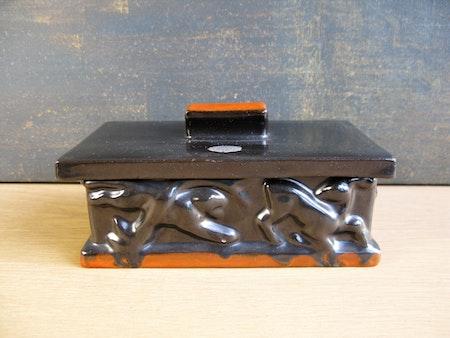 black/orange cigarette box 66