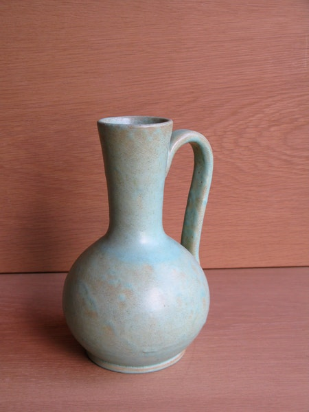 greenish vase with handle