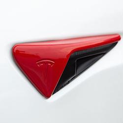 Sidoblinkers i ABS med rött utseende