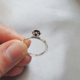 """""""North Star Sparkle"""" in gold with a 0.70ct black diamond and small TW/VS diamonds"""