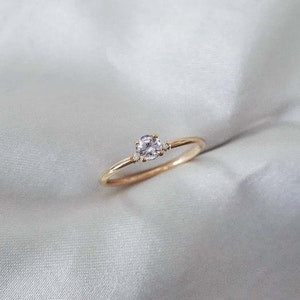 """""""Bellatrix"""" ring in gold with a light pink sapphire & diamonds"""