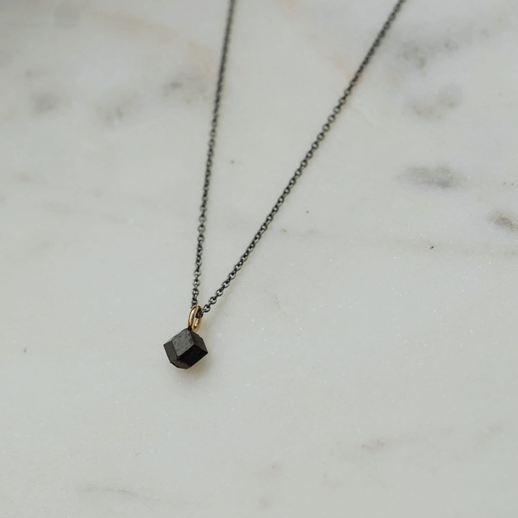 """Mini Abisko"" necklace with a raw garnet crystal found in Abisko"