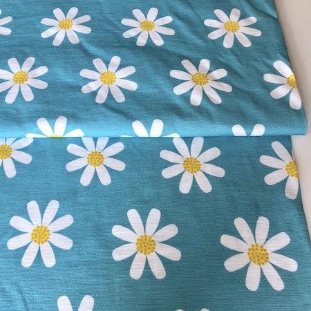 EKO Bomullsjersey - Ljusturkos med blommor