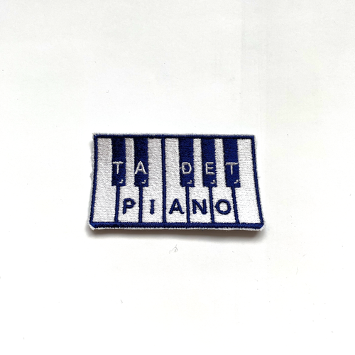 Ta det piano - tygmärke