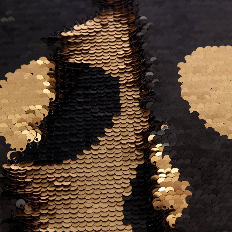 PALJETTSKALLE - Kudde med döskalle i guld och svart