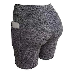 Grå elastiska Träningsshorts fickor på båda sidorna