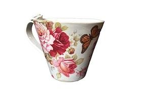 Handjord blommig keramikmugg