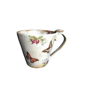 Söt keramik kopp med fjärilar