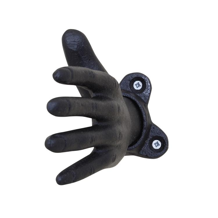 Gjutjärnshand som krok att fästa på väggen.