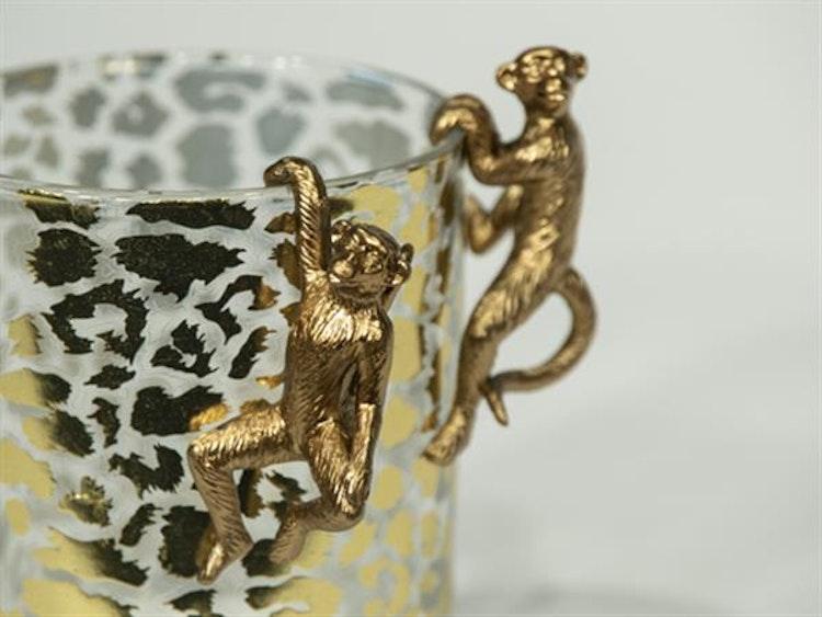 Guldapa att dekorera drinkglaset med.