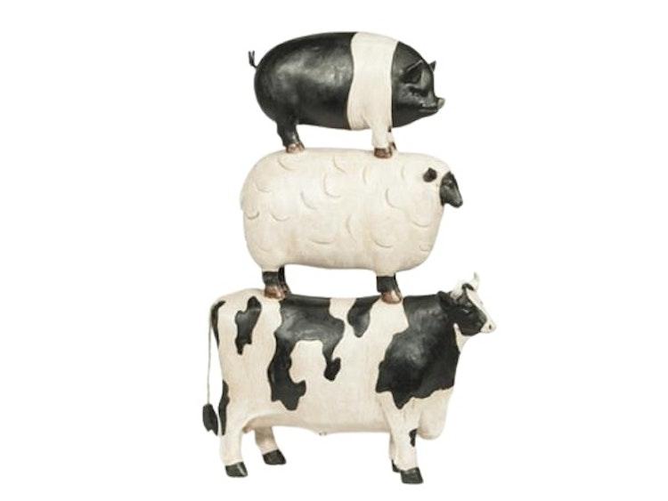 Svartvit ko, vitt lamm och gris, vacker köksdekoration.