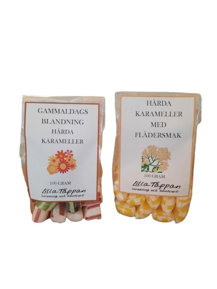Två pack av hårda karameller med smak av fläder, lakrits, hallon, kola.
